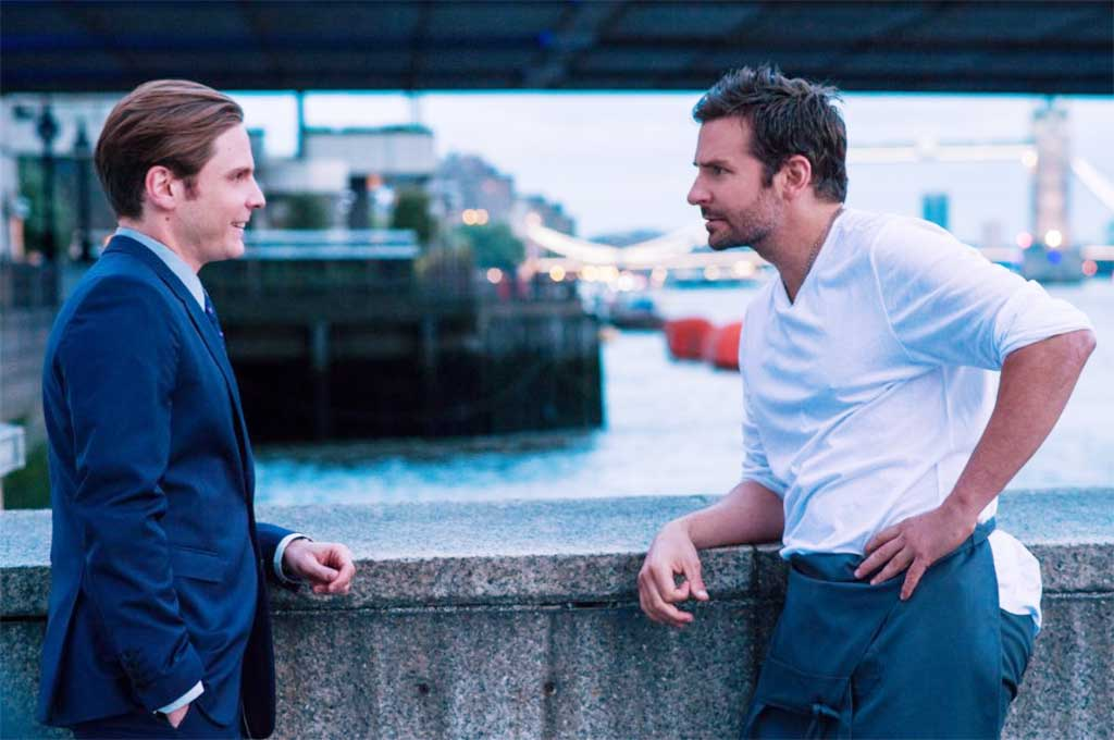Bradley Cooper speaks with Daniel Bruthl